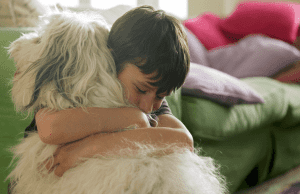 Kid hugging a dog